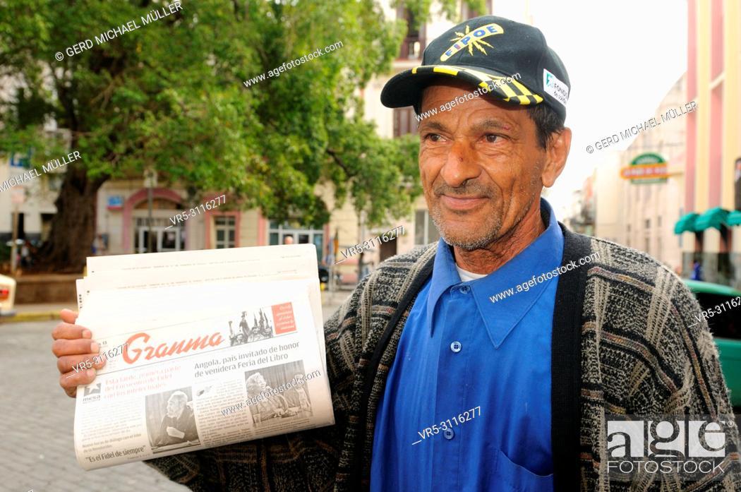 "Stock Photo: Cuban """"Granma""""-newspaper street-seller in Havanna-City."