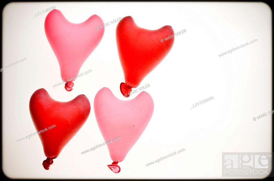 Stock Photo: Group of four heart red shaped balloons.
