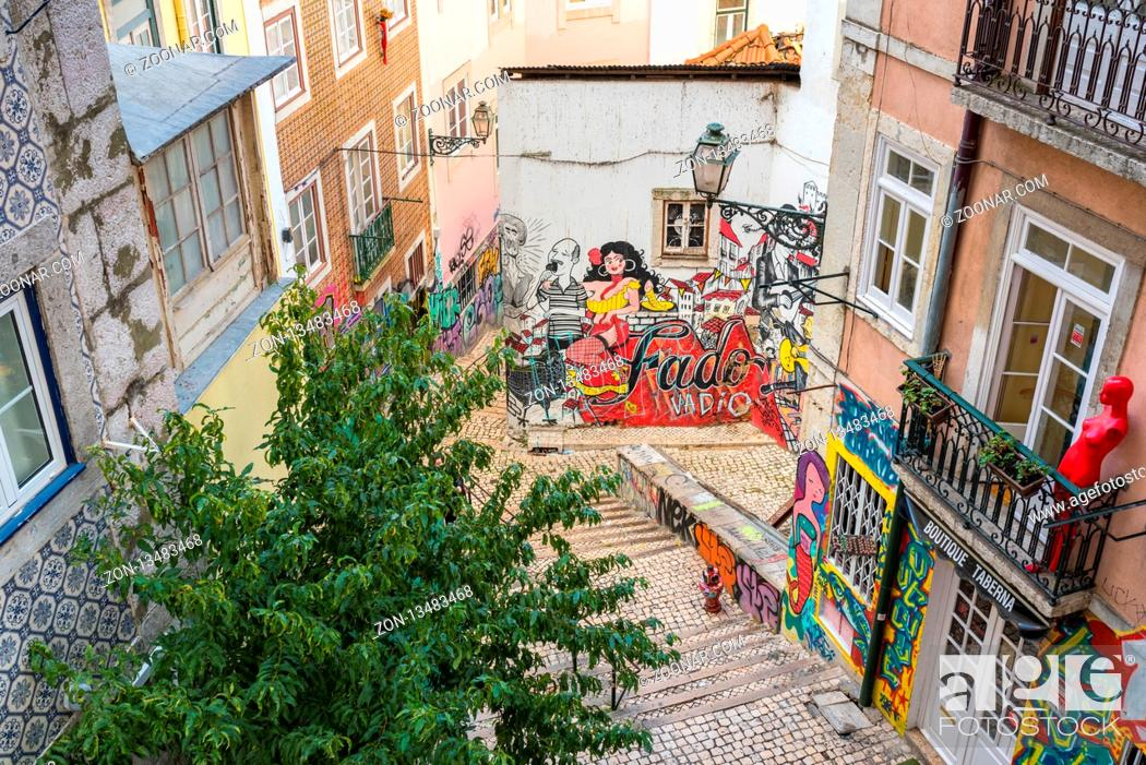 Stock Photo: Alleyway down from the neighborhood Castelo in the city of Lisbon.