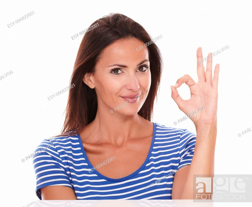 Stock Photo: Smiling lady making the ok sign while looking at camera in white background.