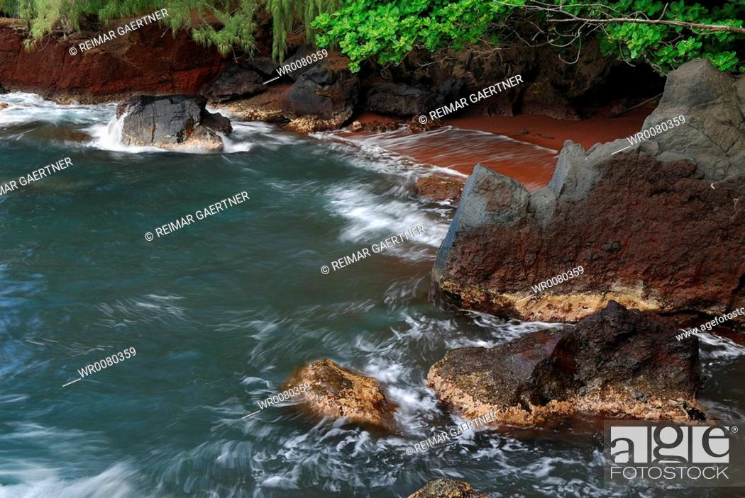Stock Photo: Red sand pocket beach at Kauiki Hill in Hana Maui.