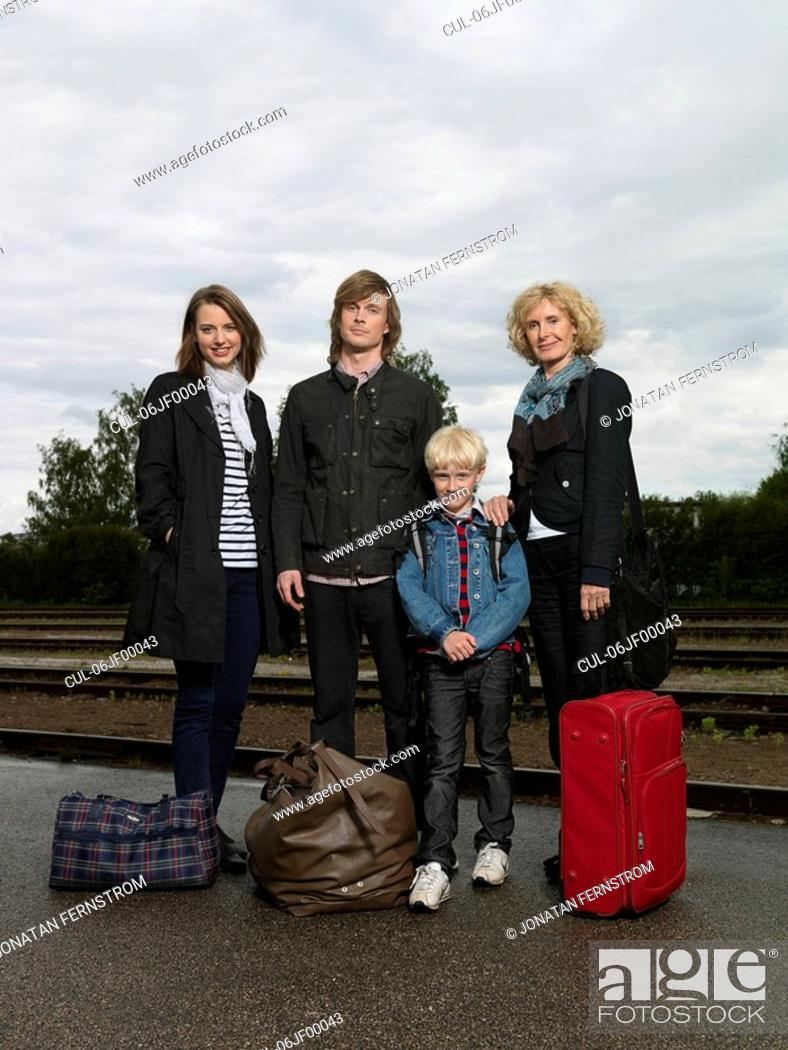 Stock Photo: Family on train station.