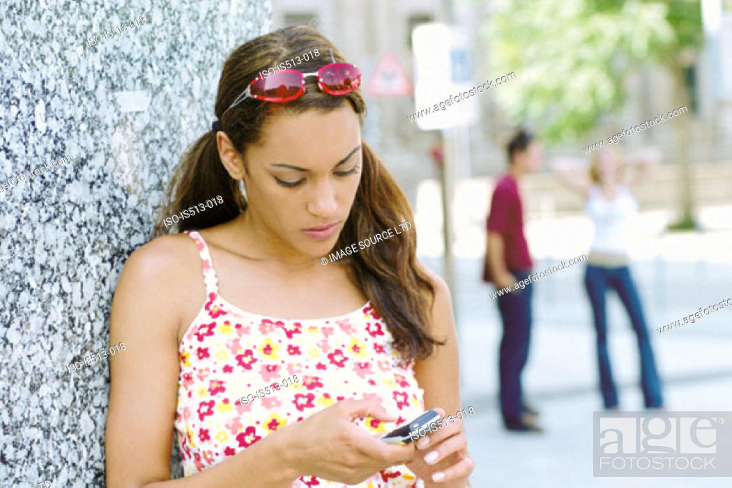 Stock Photo: Young woman using cellphone.