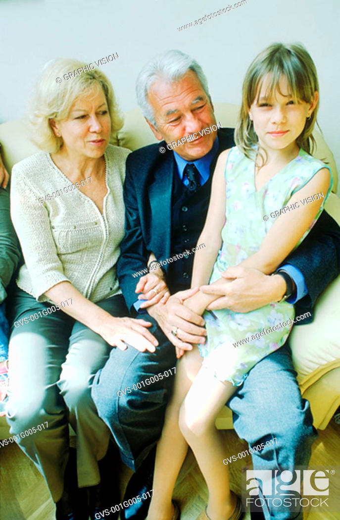 Stock Photo: Portrait of a young girl sitting with her grandparents.