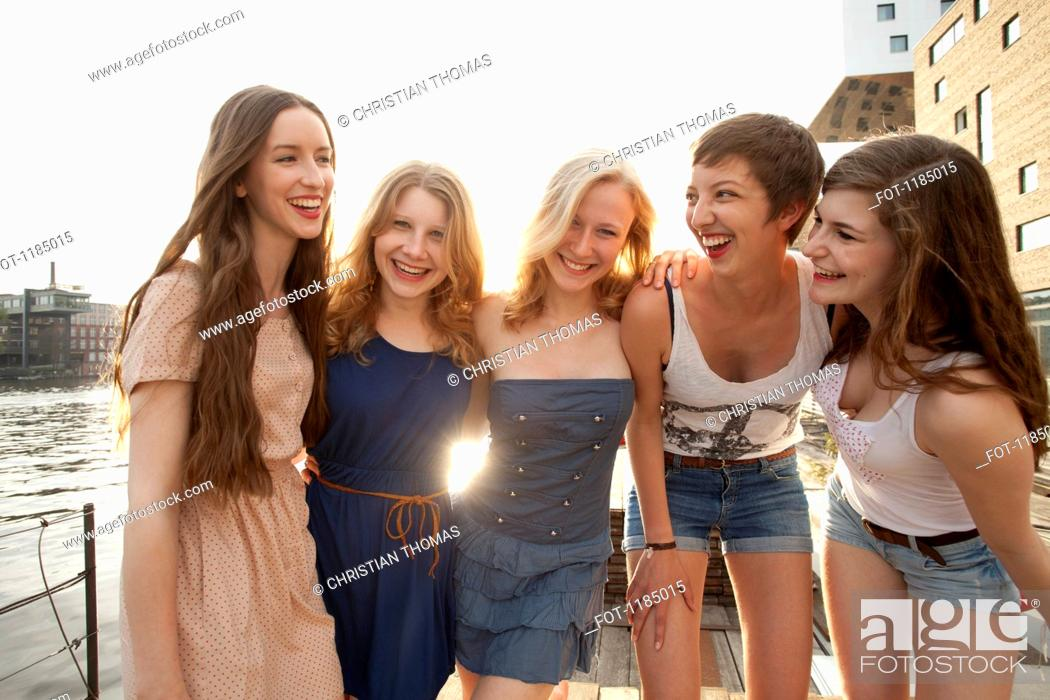 Stock Photo: Five young women standing on a jetty next to the Spree River, Berlin, Germany.
