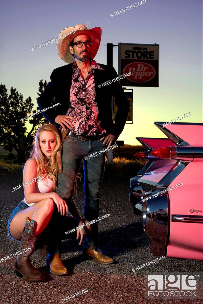 Stock Photo: American Dreamscapes, Pink Cadillac, couple posing with Cadillac.