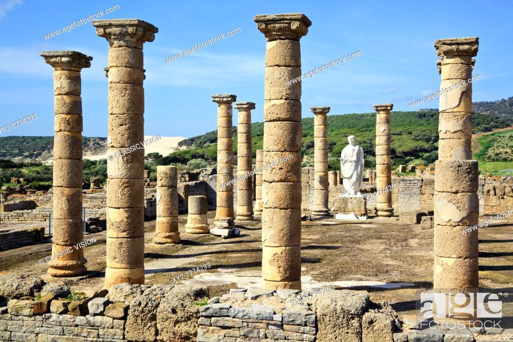 Stock Photo: Roman ruins of Baelo Claudia, at Bolonia, Cadiz Province, Spain  Statue of the Emperor Trajan in the Basilica beside the Forum.