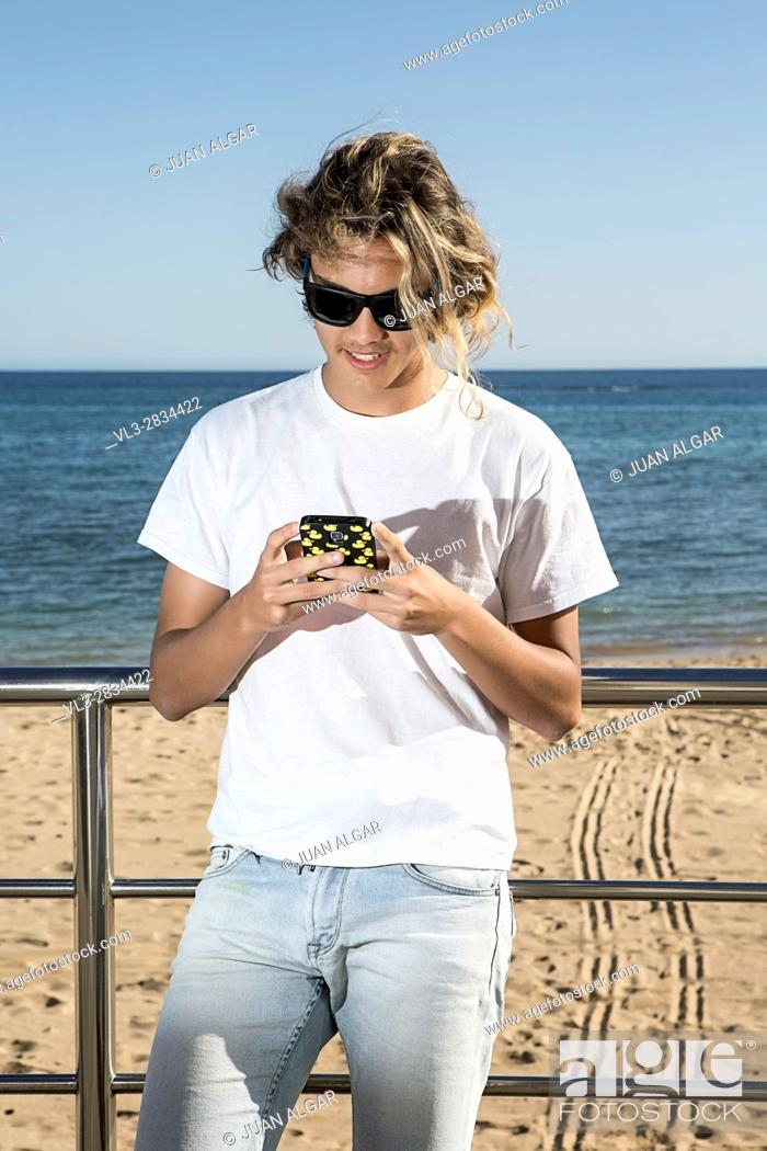 Stock Photo: Man near sea using phone.