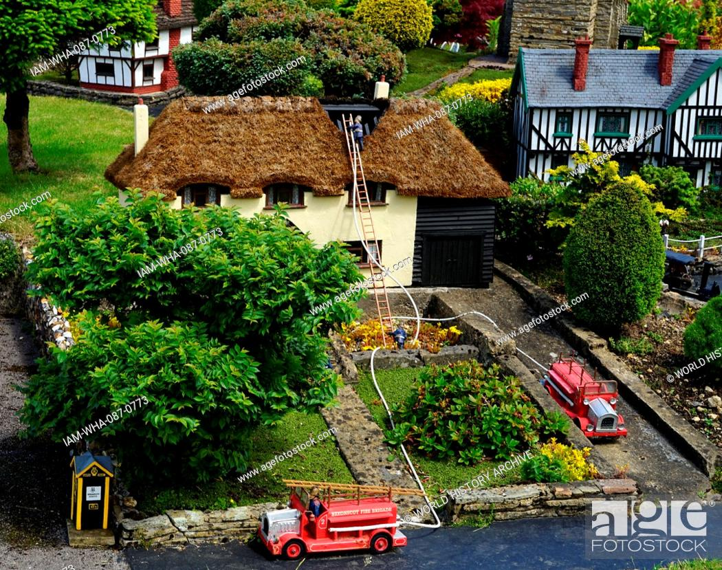 Stock Photo: Fire engines at a fire, depicted in the model village at Bekonscot in Beaconsfield, Buckinghamshire, England, is the oldest original model village in the world.