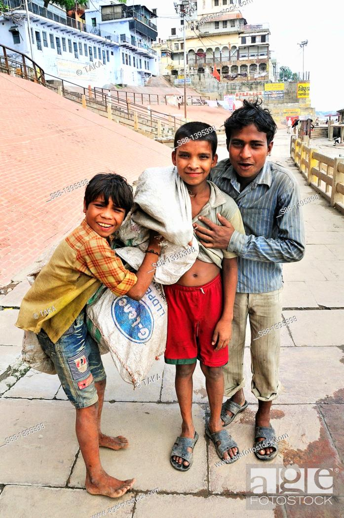 Stock Photo: Children who pick up plastic bottle to sell at the ghat by the Ganges river.