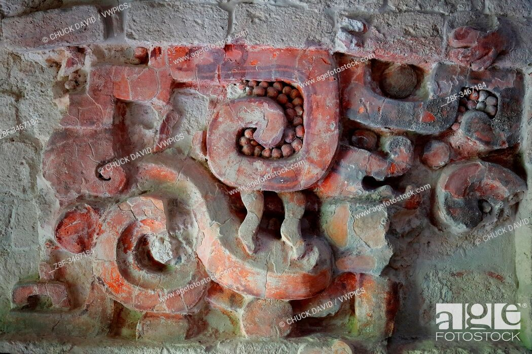Stock Photo: A close-up secion of the colorful stucco frieze inside the Sructure I temple in the ancient Mayan city of Balamku, Mexico.