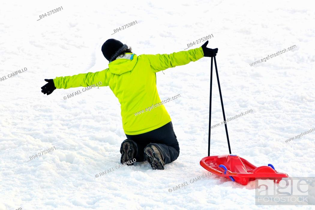 Stock Photo: Woman with a sled. La Molina, ski resort in the Pyrenees mountains of northeastern Spain, in the municipality of Alp in the comarca of Cerdanya in Girona.