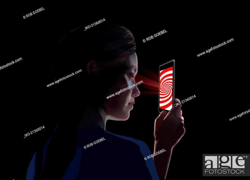 Stock Photo: Woman hypnotised by smart phone screen.