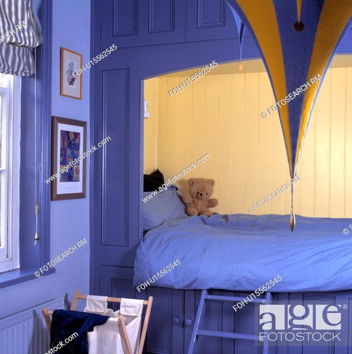 Stock Photo Blue Duvet On Bed Ed Into Alcove With Cream Panelling In Child S Esaving Bedroom