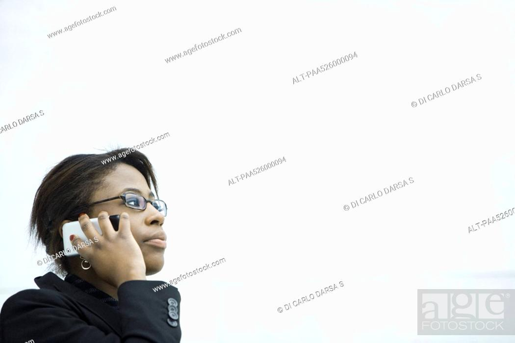 Stock Photo: Businesswoman using cell phone, looking away.
