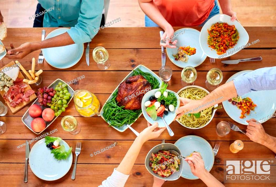 Stock Photo: thanksgiving day, eating and leisure concept - group of people having dinner at table with food.
