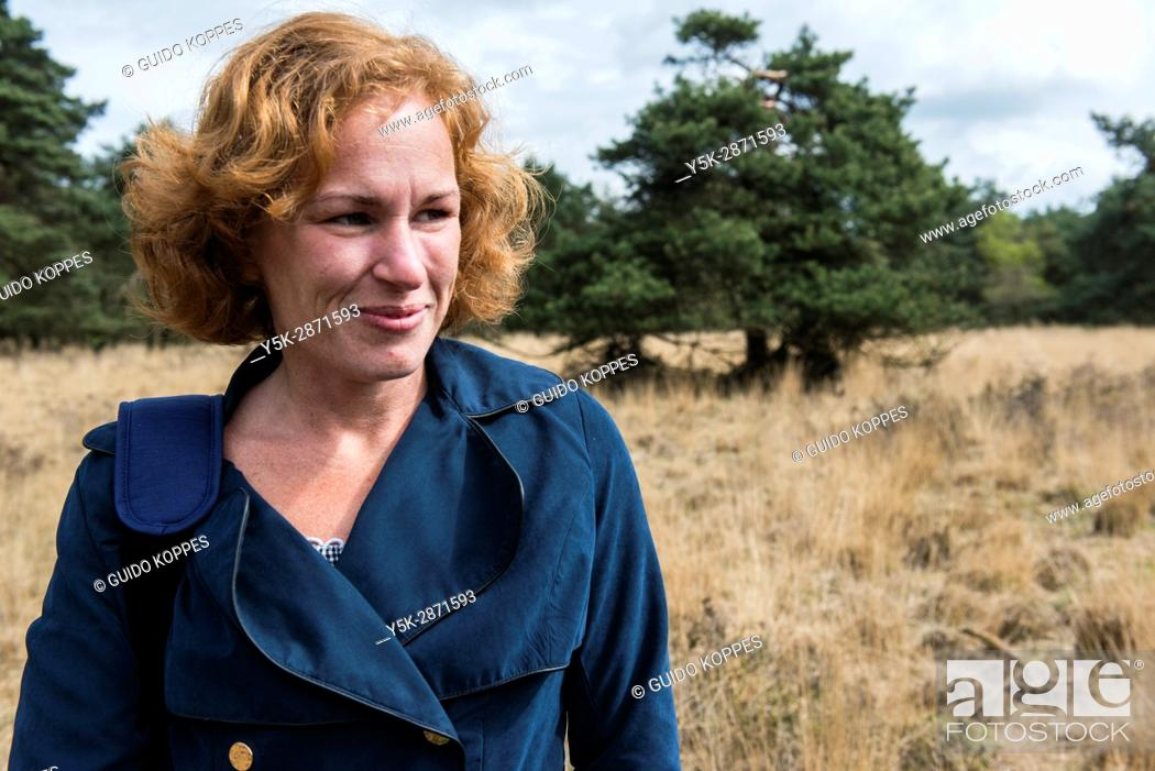 Photo de stock: Regte Heide, Riel, Netherlands. Red headed caucasian woman strolling a nature reserve park and forest on a free weekend afternoon.