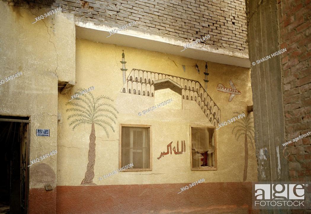 Imagen: Street scene in the City Of The Dead The Qarafa in Historic Islamic Cairo in Egypt in North Africa.
