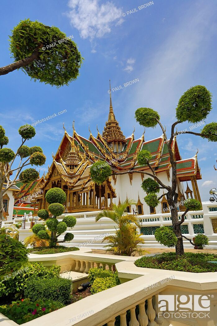 Stock Photo: Phra Thinang Dusit Maha Prasat building and spire in the Grand Palace Complex gardens and topiary, Wat Phra Kaew, Bangkok, Thailand.