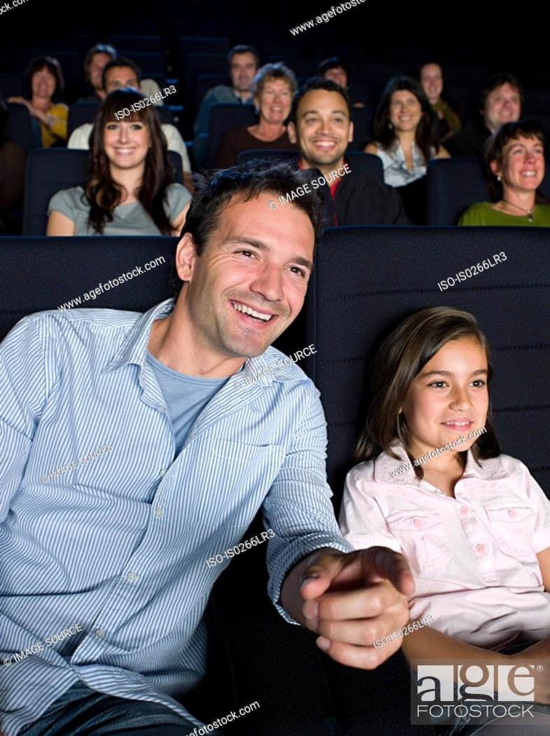 Stock Photo: A father and daughter watching a movie.