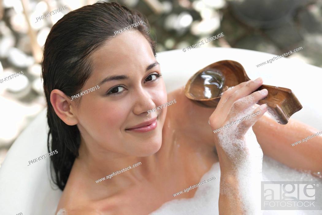 Stock Photo: Portrait of a beautiful young woman taking bubble bath.