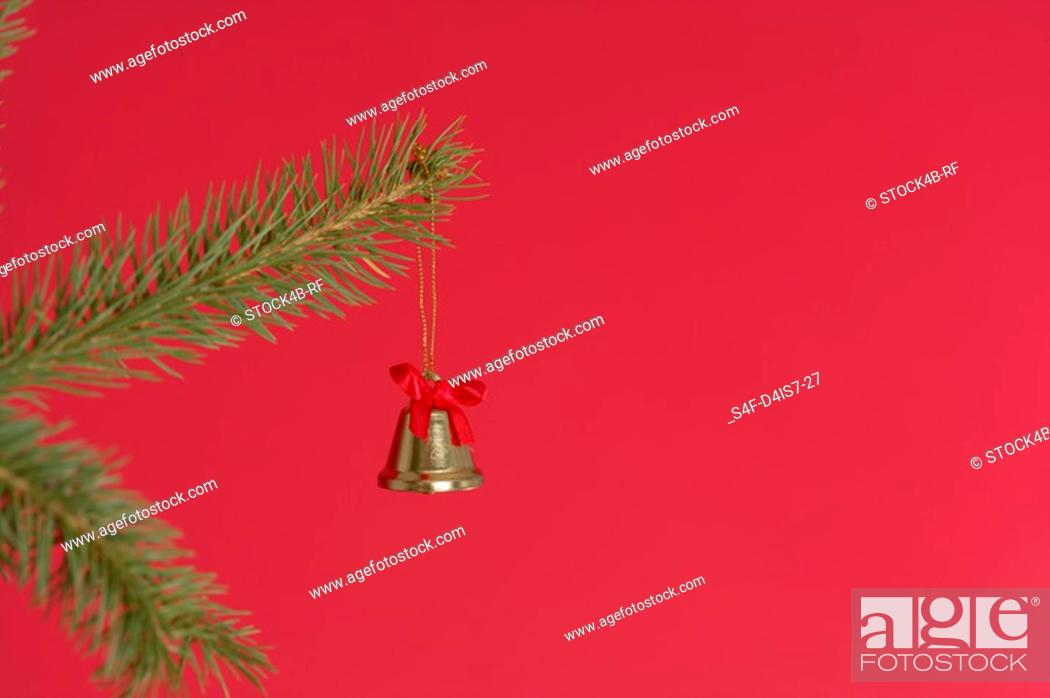 Stock Photo: Bell on a Christmas tree.