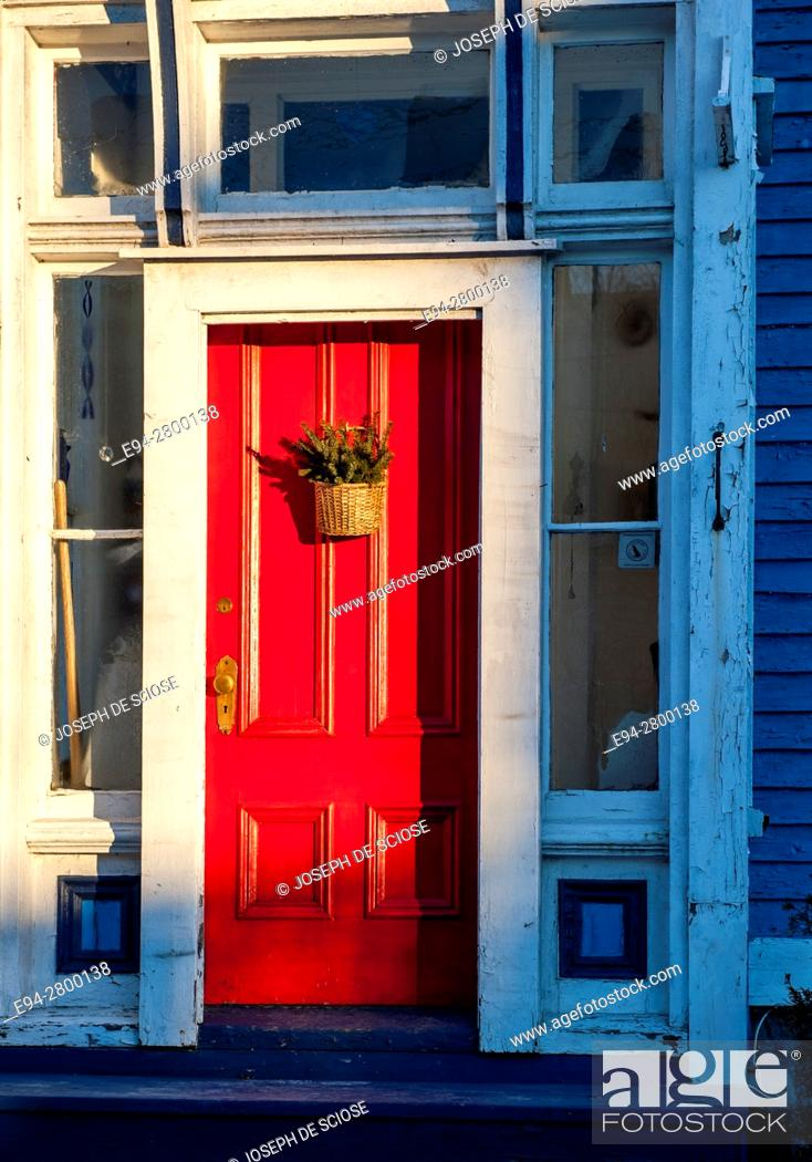 Stock Photo: Example of home architecture showing a front red door on a house in Lunenburg, Nova Scotia, Canada.