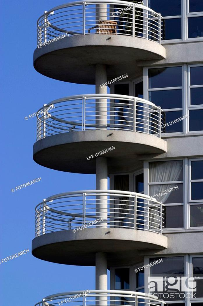 Stock Photo: Round shaped balconies on the side of a residential development,.