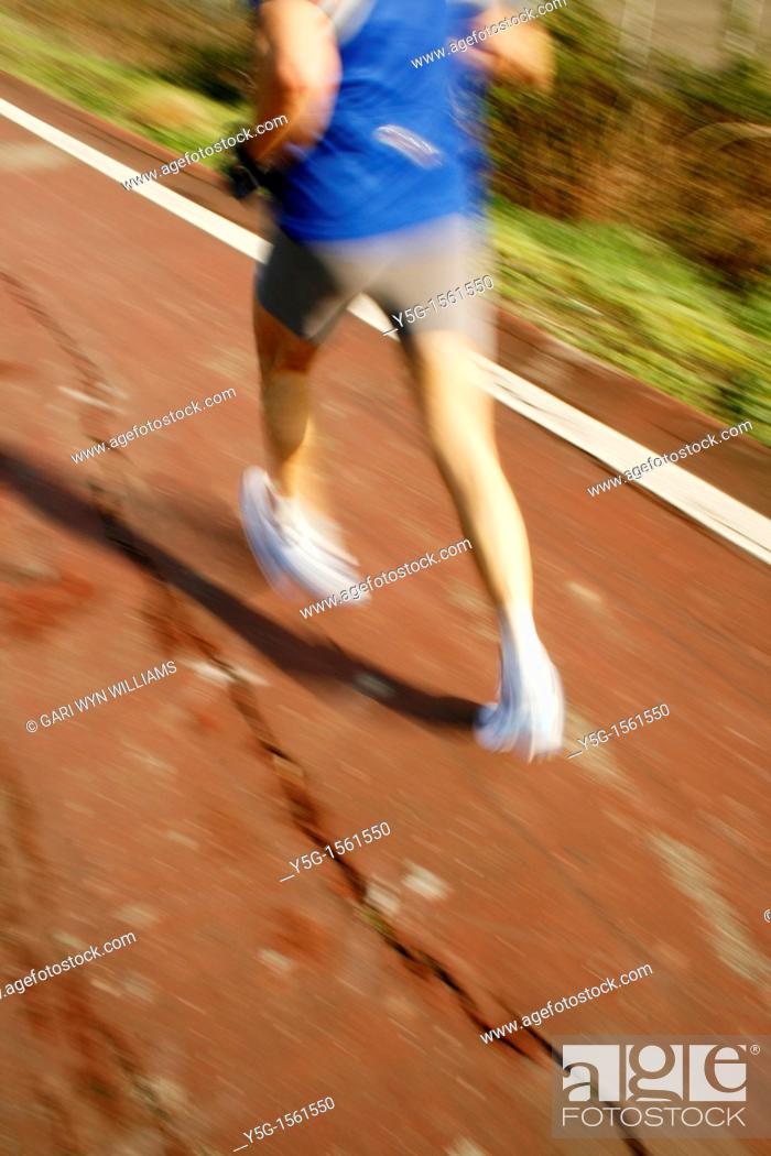 Stock Photo: one runner on footpath in park.
