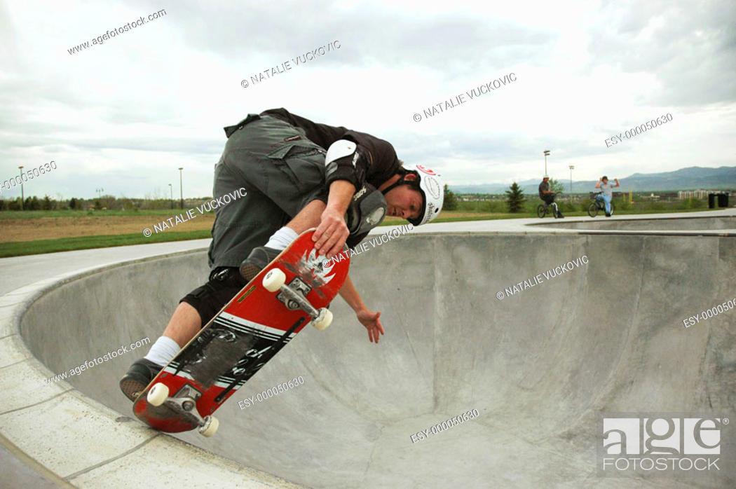 Stock Photo: Skateborader doing bowl trick in Colorado Skate Park.