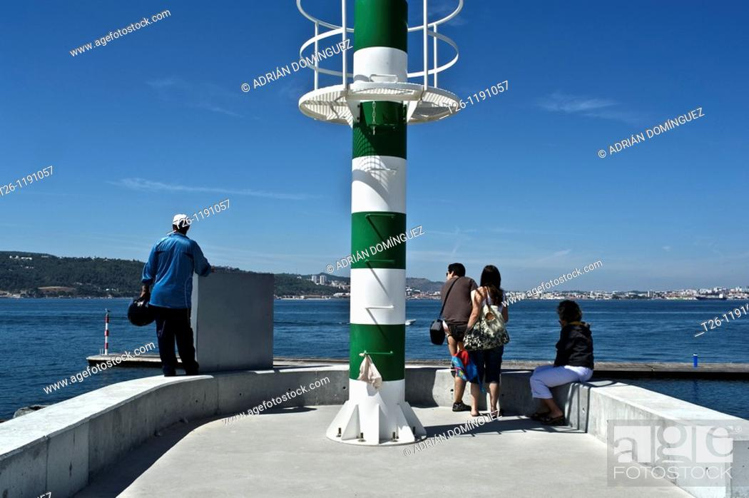 Stock Photo: People waiting to cross by ferry. Troia, Portugal.