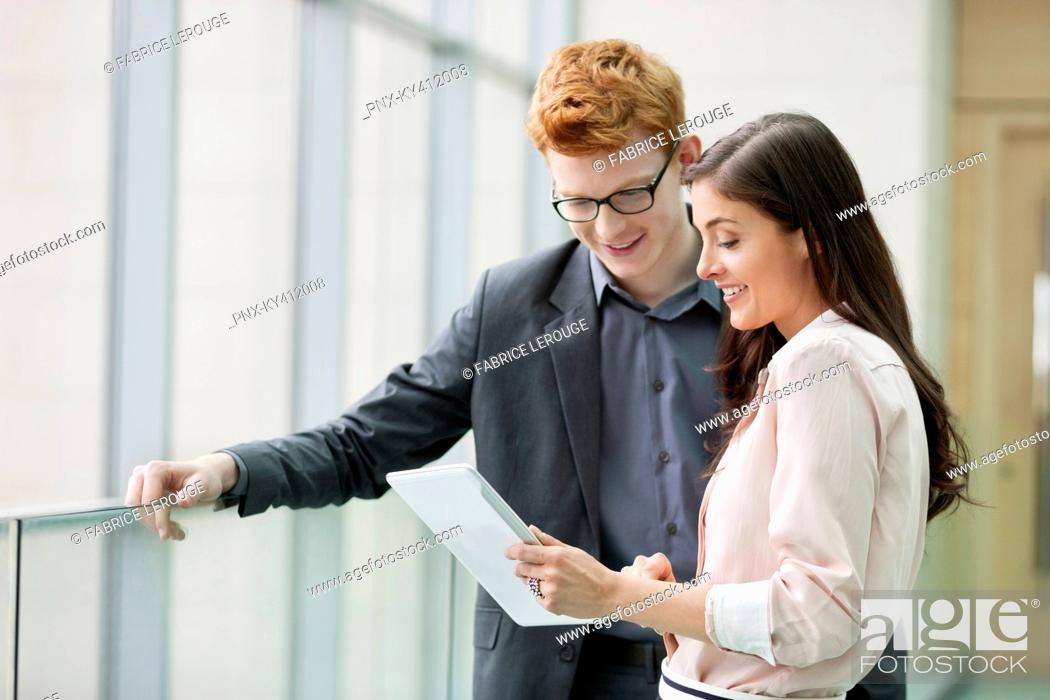 Stock Photo: Business executives using a digital tablet in an office.