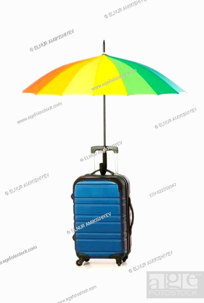 Stock Photo: Travelling concept with case and umbrella on the white.