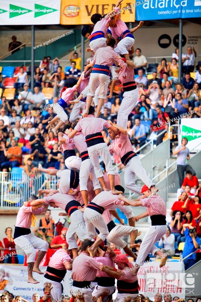 Stock Photo: Xiquets de Tarragona Human tower falling, Castellers is a Catalan tradition Biannual contest  bullring Tarragona, Spain.