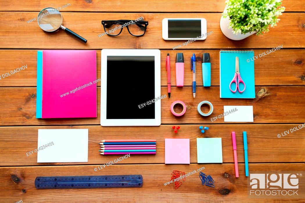 Stock Photo: education, school supplies, art, creativity and object concept - close up of stationery and tablet pc computer with smartphone on wooden table.