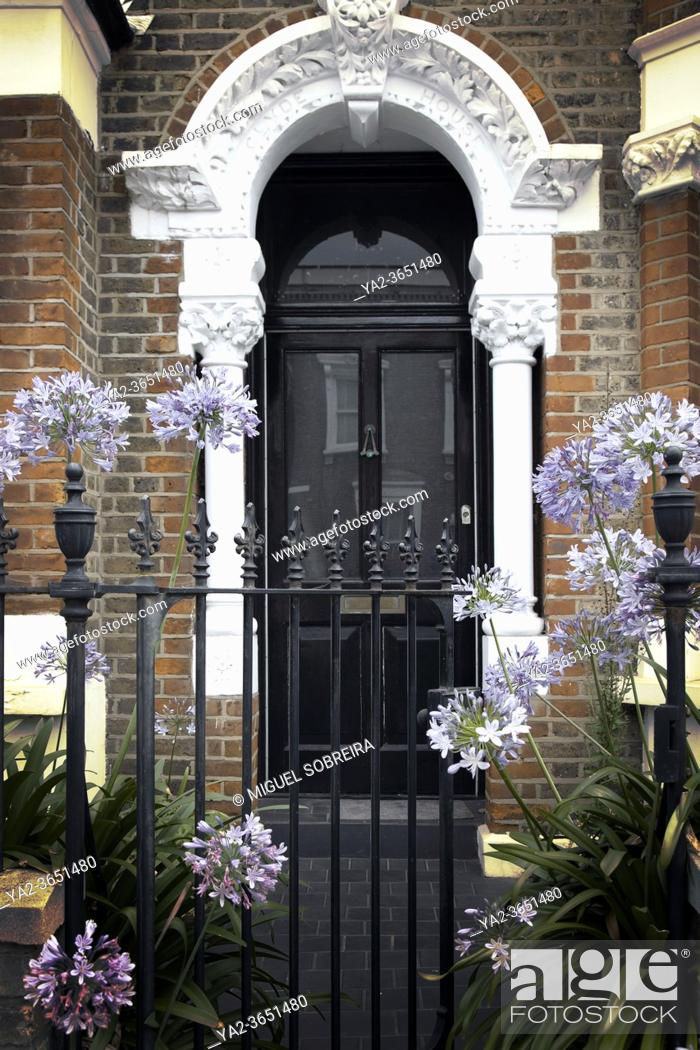 Stock Photo: FRont Doorway with Gate and Agapanthus.