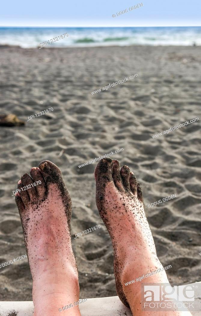 Stock Photo: Relaxing and taking in a view of the Pacific Ocean after a walk on a beach; Playa Barqueta, Panama.