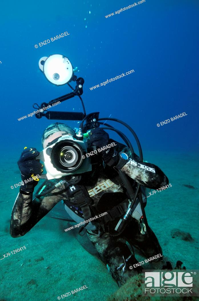 Stock Photo: Underwater photographer.