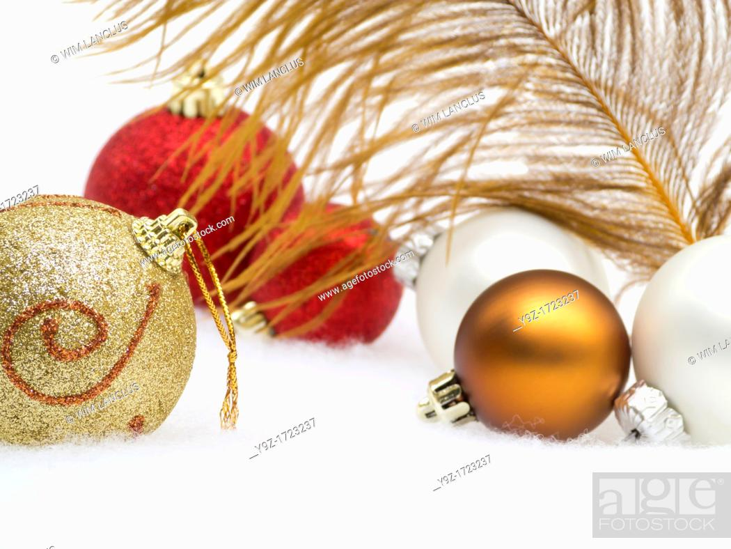 Stock Photo: Christmas decoration from baubles and feather in snow.