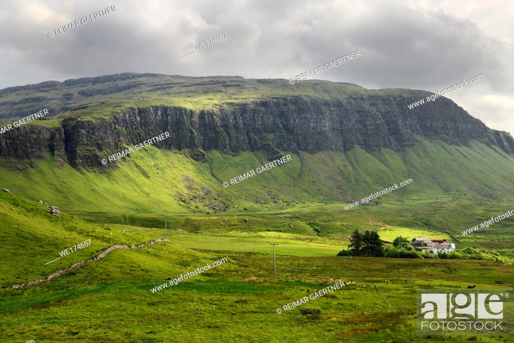 Stock Photo: Farm at Balmeanach with cliffs of Creag a Ghaill green slopes and on Loch Na Keal Isle of Mull Scottish Highlands Scotland UK.