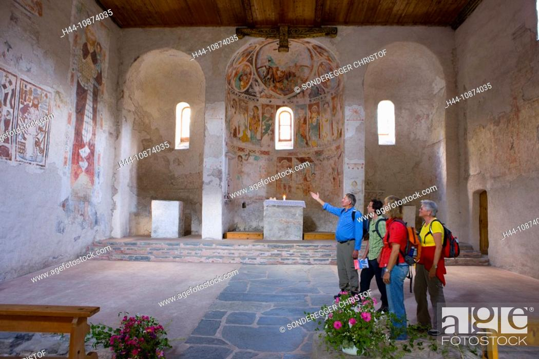 Stock Photo: Wanderer in der Kirche St.Peter in Mistail GR.