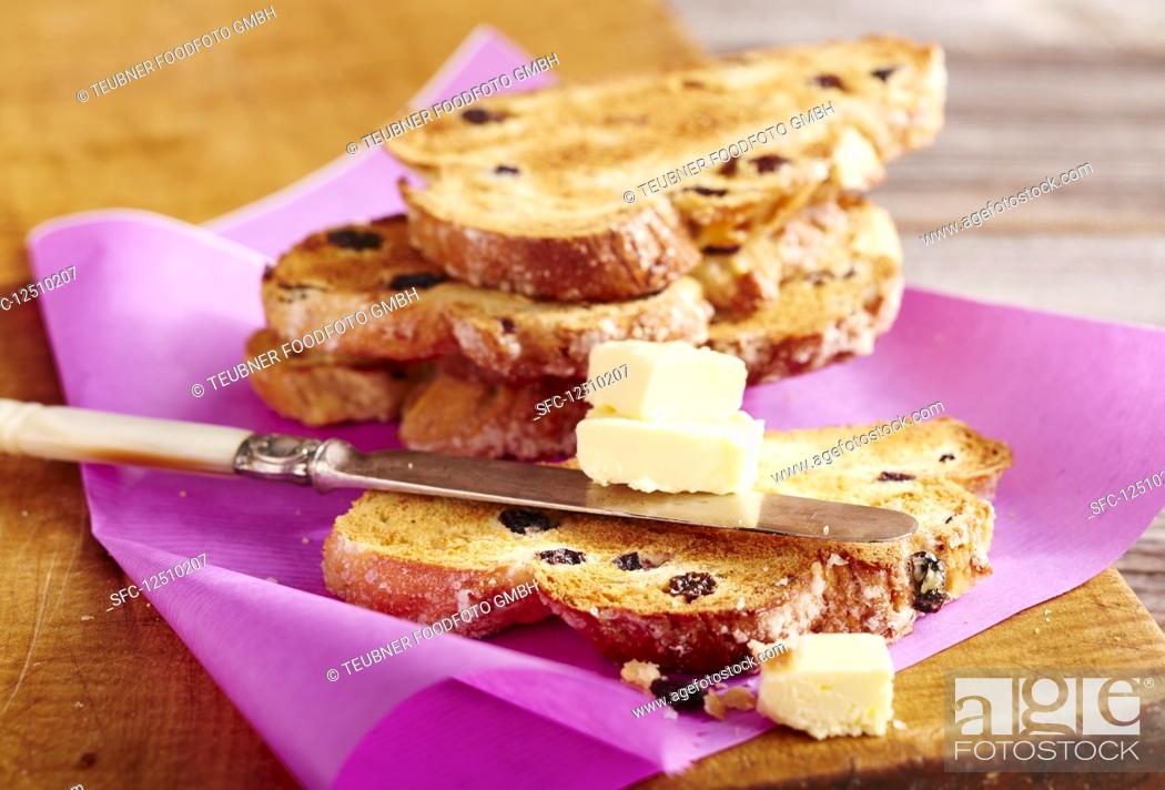 Stock Photo: Toasted raisin loaf with butter (Christmas).