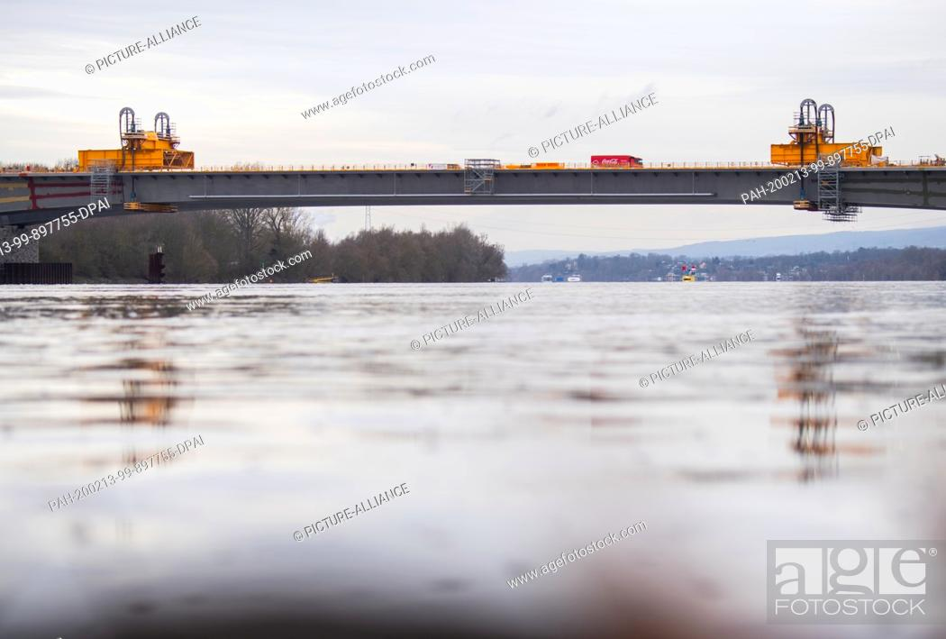 Stock Photo: 13 February 2020, Hessen, Wiesbaden: The new bridge component has reached its final position. To complete the Schiersteiner Bridge (A 643).