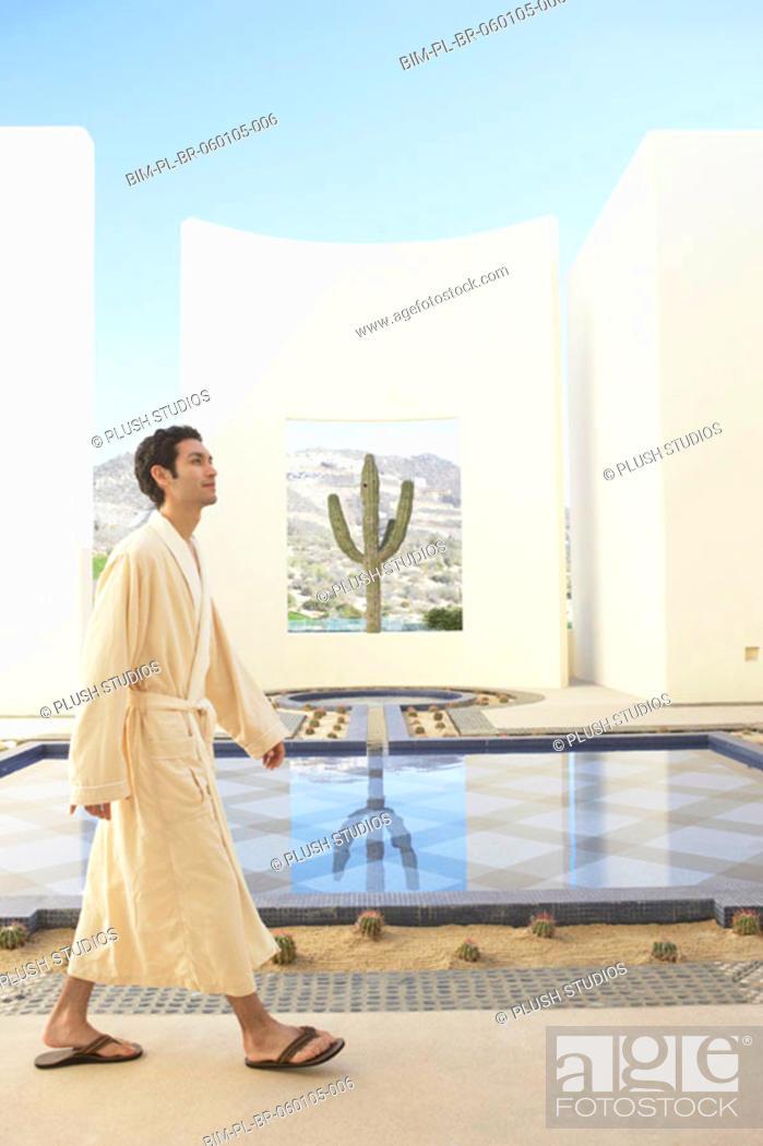 Stock Photo: Man in robe at spa resort, Los Cabos, Mexico.