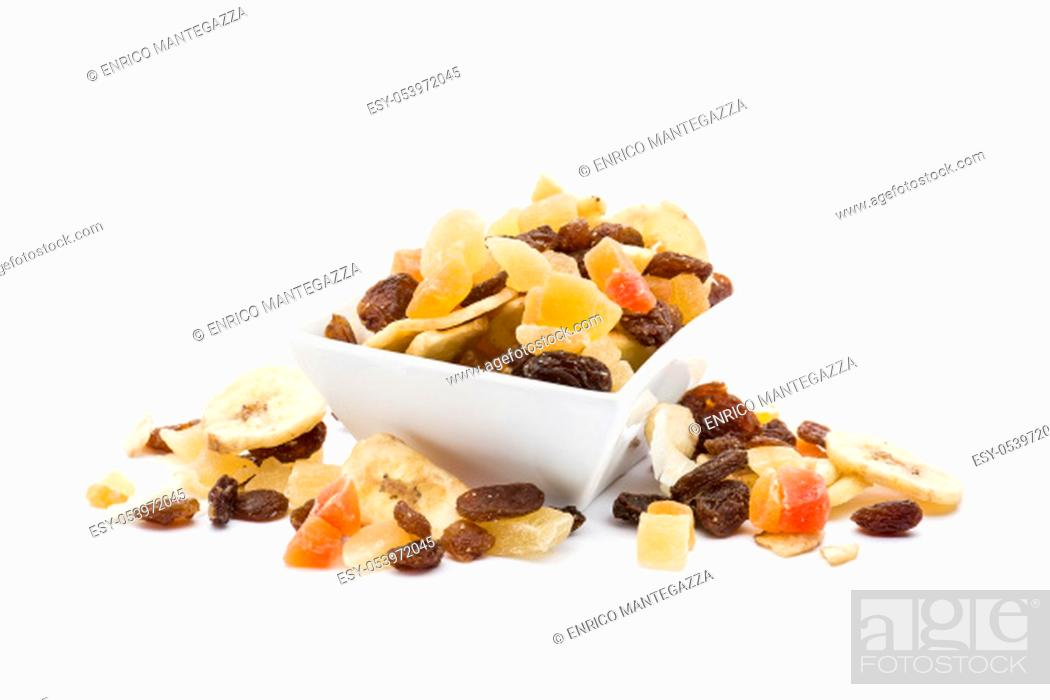 Stock Photo: Dried fruits in white bowl on white background.
