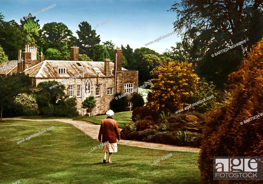 Groovy Old Woman In Front Of Manor House Prideaux Place Padstow Download Free Architecture Designs Scobabritishbridgeorg