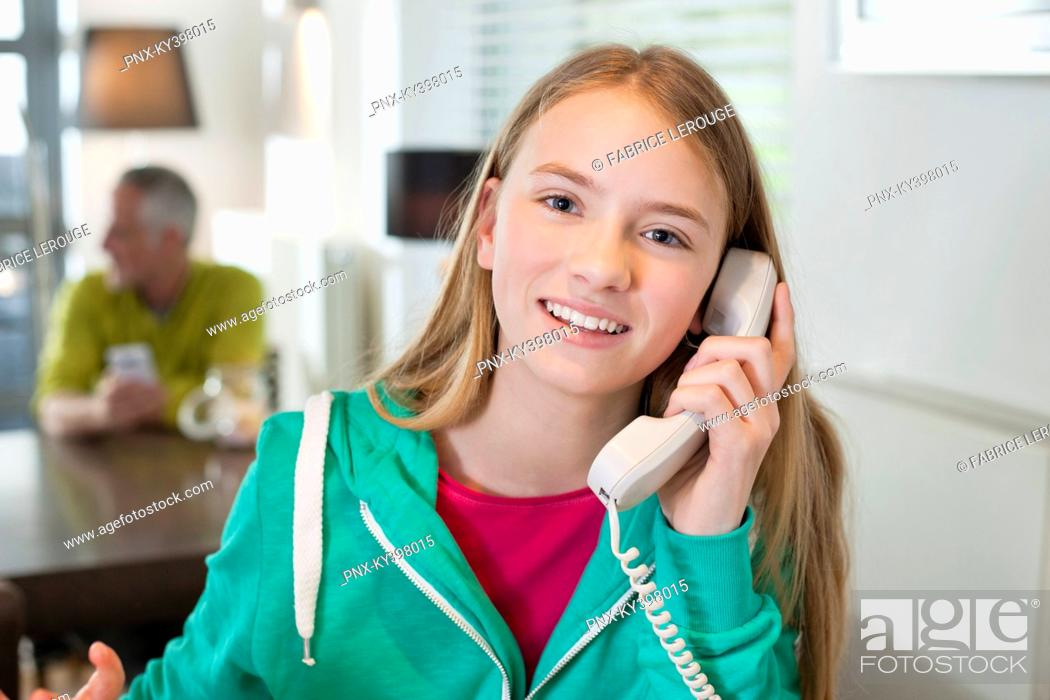 Stock Photo: Portrait of a girl talking on a phone and smiling.