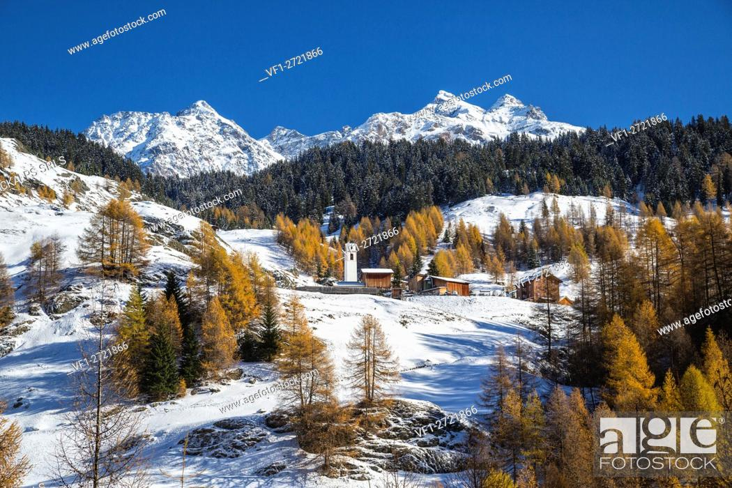 Stock Photo: Snowy landscape and colorful trees in the small village of Sur Val Sursette Canton of Graubünden Switzerland Europe.