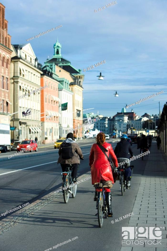 Stock Photo: Sweden, Sodermanland, Stockholm, bicyclists riding on sidewalk.