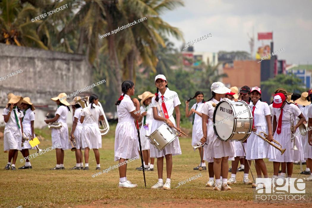 Stock Photo: school girls in uniform, members of a marching band during a parade in Galle, Sri Lanka.